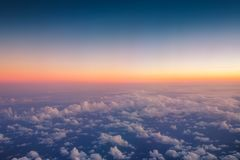 Flying above the clouds. Aerial view from the airplane royalty free stock photo