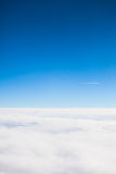 Flying above the clouds view  from a airplane porthole Stock Image