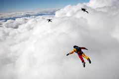 Flying above cumulus clouds Stock Photo