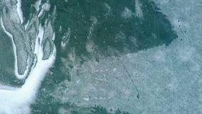 Flying above frozen lake stock video