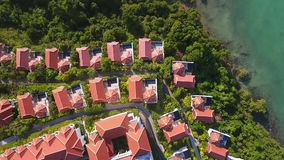 Flying above hotel with perfect exotic location. Aerial HD view. Phuket, Thailand. stock video footage