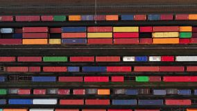 Flying above industrial railroad station with cargo trains and freight containers. stock video
