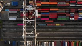Flying above industrial railroad station with cargo trains and freight containers. stock footage