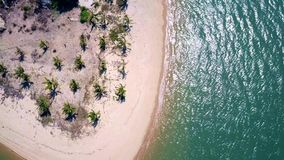 Flying above the island, over the beach and blue ocean aerial view of beautiful beach. Flying above the island with palm trees, over the beach and white sends stock footage