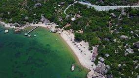 Flying above the island, over the jungle and blue ocean Aerial view of beautiful beach stock footage