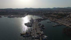 Flying above Lavrio marina and port. Yachts, sail boats, cruise ships. Flight above marina, port, yacht parking of Lavrio coastal city. Sailing boats, yachts stock footage
