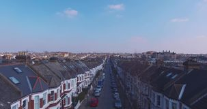 Flying above London surburban houses and apartments aerial view at dawn on sunny day stock footage
