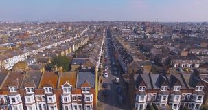 Flying above London surburban houses and apartments aerial view at dawn on sunny day stock video footage