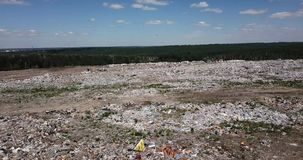 Flying above an lot of garbage in the dump near the Novosibirsk city. In Russia, that rots and infects the earth and the animal world. Birds flyong above the stock footage