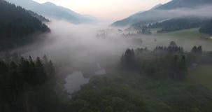 Flying above mist covered lake. Zelenica nature resort near Kranjska Gora, Slovenia stock footage