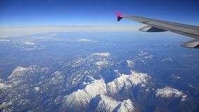 Flying above mountains snow stock footage