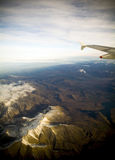 Flying Above Mountains at Sunset Stock Image