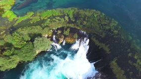 Flying above national park of Una river and its clear waterfalls, Bosnia stock video footage