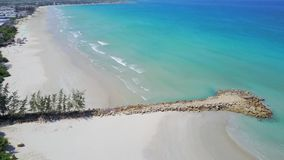 Flying above the pier, over a reef and blue ocean Aerial view of beautiful beach stock footage