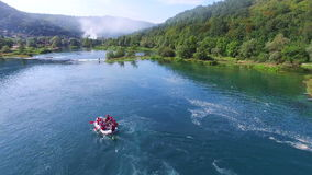 Flying above rafters approaching waterfall on Una river in Bosnia stock video footage