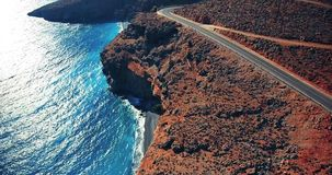 Flying above road by seashore stock footage