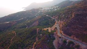 Flying above serpentine road. In mountains at Crete Island stock video footage