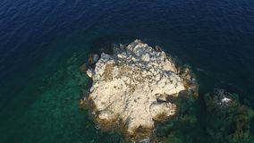 Above Islet. Flying above a small barron islet of the Aegean Sea in Greece stock video footage