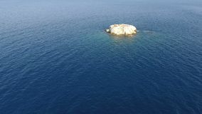 Above Islet. Flying above a small barron islet of the Aegean Sea in Greece stock video