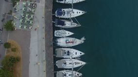 Above a Jetty with Sailing Yachts. Flying above a small jetty with sailing yachts during nightfall stock video