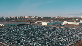 Flying Above Storage Parking Lot of New Unsold Cars stock video footage