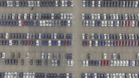 Flying Above Storage Parking Lot of New Unsold Cars, aerial view stock video footage