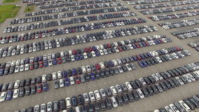 Flying Above Storage Parking Lot of New Unsold Cars, aerial view stock video