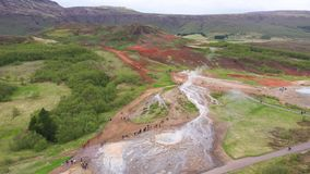 Flying above Strokkur geysir in Iceland, aerial high angle drone view stock video footage