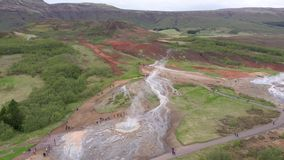 Flying above Strokkur geysir in Iceland, aerial high angle drone view stock footage