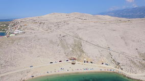 Flying above tourists on isolated beach of Pag island, Croatia. Flying above tourists on beautiful isolated beach of Pag island, Croatia stock video