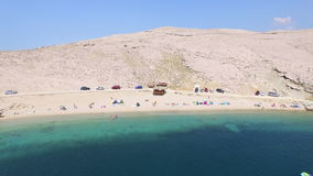 Flying above tourists on isolated beach of Pag island, Croatia. Flying above tourists on beautiful isolated beach of Pag island, Croatia stock video footage