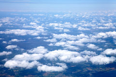 Flying above white clouds. View from an airplane window, flying above white clouds over Ireland Royalty Free Stock Images