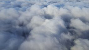 Above the clouds. Flying above the white clouds blanket Royalty Free Stock Images