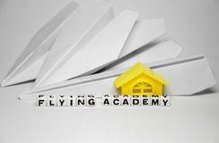 Flying academy. Image with paper planes and letters of text along with the building royalty free stock image