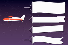 Flying advertising banner. Plane with horizontal banners in night outer space background Stock Images