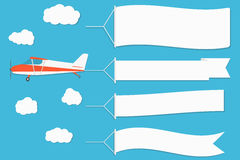 Flying Advertising Banner. Plane With Horizontal Banners On Blue Sky Background. Royalty Free Stock Photography