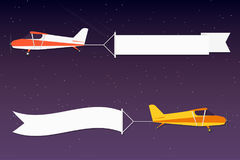Flying advertising banner. Planes with horizontal banners in night outer space background Royalty Free Stock Images