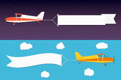 Flying advertising banner. Planes with horizontal banners in night outer space and day blue sky background Stock Photo