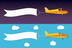 Flying advertising banner. Planes with horizontal banners in night outer space and day blue sky background Stock Image