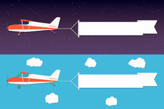 Flying advertising banner. Planes with horizontal banners in night outer space and day blue sky background Stock Photography