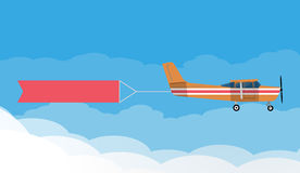 Flying advertising banners pulled by light plane Stock Photography