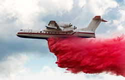 Flying aerial firefighting pour water Stock Images