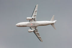 Flying air plane. Flying plane in the dramatic sky royalty free stock image