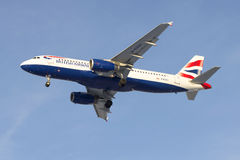 Flying Airbus A320-232 (G-EUUU) British Airways in the blue sky Royalty Free Stock Image