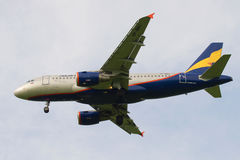 The flying Airbus A319-112 plane VP-BBU of Donavia airline close up in the cloudy sky Stock Images