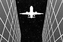 Flying aircraft between glass buildings at night Stock Images