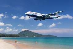 Flying aircraft over the beach Stock Image