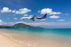 Flying aircraft over the beach Royalty Free Stock Photo