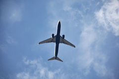 A flying airplane Stock Photography