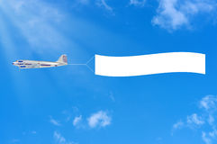 Flying airplane and banner. Royalty Free Stock Images